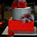 130x130 sq 1447902921 9747accc04318584 img 2467.jpg red black bling poof cake on table pic