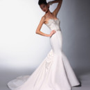 VH144 Strapless mermaid natural waist gown with lace bodice and satin skirt. Embroidery at neckline and waist applique.