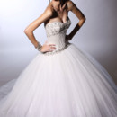 VH140  <br /> Strapless ball gown with boned satin bodice and full layered tulle skirt with embroidery at neck and hip lines.