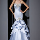 VH157  Strapless satin gown, fit to flare, assymetric flounced skirt,with embroidered neckline and drop hip line.