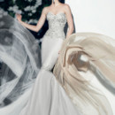 Victor Harper Couture Style VHC286  Strapless tulle column gown with beaded bodice and skirt design.