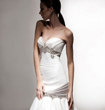 VH100 Satin strapless fit to flare gown with draped bodice and sash with jeweled trim on neckline, hip and sash.