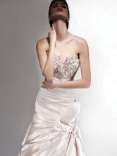 VH105 Satin strapless fit to flare gown with jeweled bodice and draped side bow skirt.