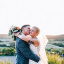 130x130 sq 1478804779 69b587150add5193 brideandgroom kiss