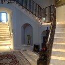 130x130_sq_1358901522338-castlefoyer2