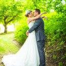 130x130 sq 1377655477778 wedding kiss