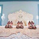 130x130 sq 1360632238996 shoes