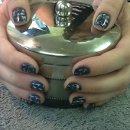 130x130 sq 1359675521507 marblenails2