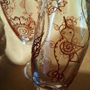 Each Mehndi Glass is a one of a kind custom order. Artisan created with your preferences in Mehndi/henna style designs hand painted in metallic colors of gold, copper or pewter. Optional personalization. Available in Red wine, white wine & champagne flutes. This set of champagne flutes in copper is an example of what I can create for you!