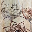 Each Mehndi Glass is a one of a kind custom order. Artisan created with your preferences in Mehndi/henna style designs hand painted in metallic colors of gold, copper or pewter. Optional personalization. Available in Red wine, white wine & champagne flutes.