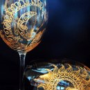 Each Mehndi Glass is a one of a kind custom order. Artisan created with your preferences in Mehndi/henna style designs hand painted in metallic colors of gold, copper or pewter. Optional personalization. Available in Red wine, white wine & champagne flutes. This set of red wine glasses in gold is an example of what I can create for you!