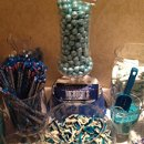 The candy buffet we designed for Beth & Brian included towers of shimmer gum balls, custom-wrapped chocolate bars, blue-striped marshmallows, gummy sharks and taffy.