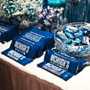 A close-up shot of the blue candy table designed for Beth & Brian, which included customized chocolate bars featuring the newlyweds' last name.