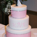 An all-buttercream cake with large pink ribbon and faux diamonds to add just the right amount of bling!