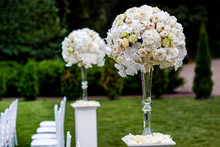 220x220 1430064158208 tall centerpieces hydrangeas roses orchids