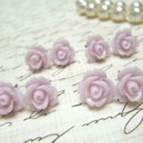 Four (4) Pair TinyThistle Purple Flower Earrings, Thistle Rose Earrings, Stud Earrings, Bridesmaid Jewelry, Vintage Style Earrings, Hypoallergenic. Tiny thistle-colored rose stud earrings are that perfect vintage inspired touch to your look. Thistle-colored roses of resin are attached to surgical steel posts.