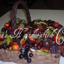 130x130 sq 1364935211027 fruit basket cake1