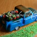 130x130 sq 1364935285616 truck cake2