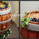 130x130 sq 1364935289362 wine barrel cake4