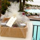 Wedding Welcome Gift wrapped in Ivory Tulle with Gourmet Goodies inside of an eco-friendly jute basket.