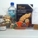FIJI Water, Water Crackers, Jellies, Cheeses, Godiva Bar, wooden spreader, Trail Mix, Emergency Bag