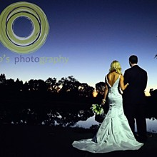 220x220 sq 1320207641945 whitneyoaksweddingsunsetbrideandgroom