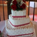 Served 120 guests. Mixed designs and red ribbon to match the wedding color. Each tier was off-set.