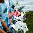 The bride's and bridesmaids' bouquets at a lakefront wedding.