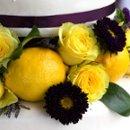 130x130 sq 1264527873579 cakewithyellowandpurpleflowersandlemons