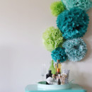 130x130 sq 1393255196533 tissue paper pom pom backdro
