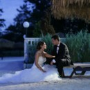130x130 sq 1484407555087 bride sitting on beach with groom