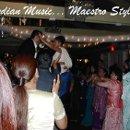 130x130 sq 1345076035858 indianmusicmaestrostyle