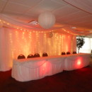 2 panel backdrop and 2 head tables. Uplights come in 16 colors and white strands of lights on backdrop