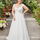 Brand: Glamour Plus Collection Style: 5545T Slimmer smaller gown with sweet heart neckline and cross over bust feature finishing at the empire line with a beautiful beaded brooch. Draping from the beaded feature adds fullness to the skirt. Ruched detachable straps.