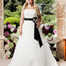 Brand: Glamour Plus Collection Style: 5533T Traditional elegant classic A-line gown of lace, paneled through front and back for an elegant fit. The waist is finished with a contrast detachable sash and beaded flower corsage. Fabrics: