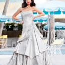 Brand: Diamond Collection Style: Romal Style Code: 5481T Ornate full gown with traditional qualities of cut out embroidery work through the bodice and around the hemline.
