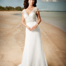 Brand: Diamond Collection Style: Zella Style Code: 5569T Contemporary slim gown with sweetheart neckline and slim soft skirt with separate train catches from back waist. Features a beaded embroidered cap sleeve short over bodice.