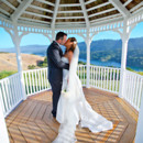 130x130 sq 1414429889625 bride and groom gazebo kiss
