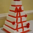 130x130 sq 1399305994162 square wedding cake with red ribbo