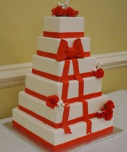 220x220_1409083668364-square-wedding-cake-with-red-ribbo