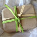 Wedding favor box with green and natural raffia ribbon