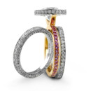 Pink Equinox Two Oleander Bands Pink Sapphires set in a yellow gold shank with a pave framed round center stone. Two matching three-sided pave bands.