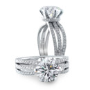 Bouquet Our Bouquet ring has a split pave shank that holds a round center stone with an under bezel pave wrap.