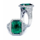 Emerald Alexa This 5 Carat green emerald ring is the ultimate expression of love. The shank is set with our patented Blaze cut diamonds.