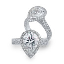 Pear-Shape Tulip A pear shape center with a frame and two row curved pave shank set in Platinum, 18karat White gold or Yellow gold.