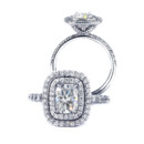 Gardinia Cushion cut center with a double pave frame, crescent shape pave head and a french cut set shank.