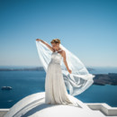 Our stunning bride last summer in Santorini Greece..Their love made them come to our beautiful island with their friends and family to make their marriage and we were there to keep their memories alive.