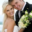 130x130 sq 1370743358036 11962434 pretty blond bride and her handsome groom at the sea shore