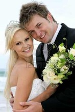 220x220 1370743358036 11962434 pretty blond bride and her handsome groom at the sea shore