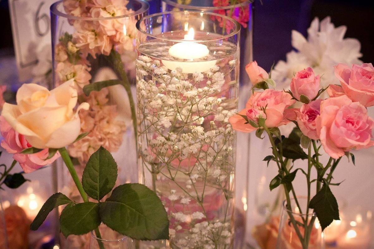 Candlelight vows officiant orlando fl weddingwire for How to make flowers float in vases